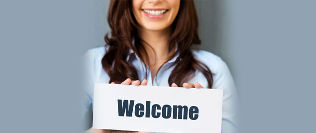Woman with Welcome Sign